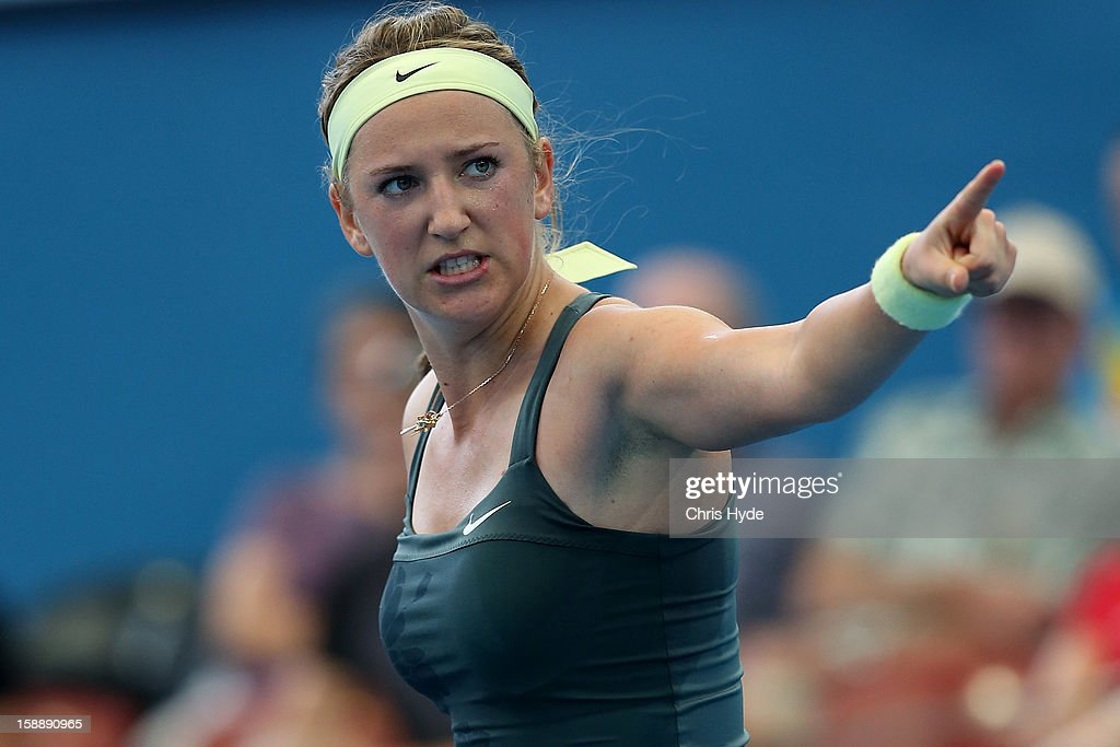 <a gi-track='captionPersonalityLinkClicked' href=/galleries/search?phrase=Victoria+Azarenka&family=editorial&specificpeople=604872 ng-click='$event.stopPropagation()'>Victoria Azarenka</a> of Belarus celebrates winning her match against Ksenia Pervak of Kazakhstan during day five of the Brisbane International at Pat Rafter Arena on January 3, 2013 in Brisbane, Australia.