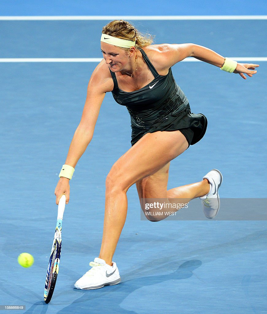 Victoria Azarenka of Belarus hits a backhand return against Sabine Lisicki of Germany in the second round at the Brisbane International tennis tournament on January 2, 2013. AFP PHOTO/William WEST USE
