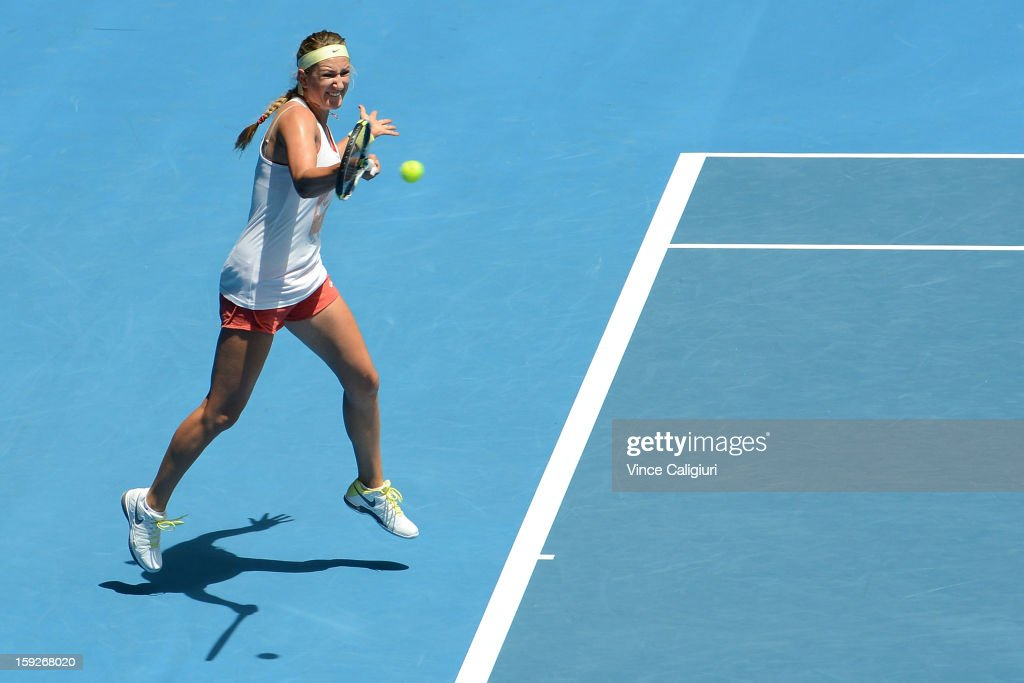 <a gi-track='captionPersonalityLinkClicked' href=/galleries/search?phrase=Victoria+Azarenka&family=editorial&specificpeople=604872 ng-click='$event.stopPropagation()'>Victoria Azarenka</a> of Belarus hits a forehand during a practice session ahead of the 2013 Australian Open at Melbourne Park on January 11, 2013 in Melbourne, Australia.