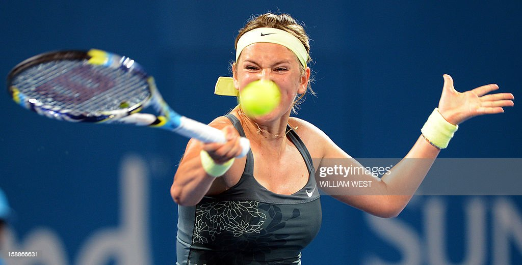 Victoria Azarenka of Belarus hits a forehand return in her match against Sabine Lisicki of Germany in the second round at the Brisbane International tennis tournament on January 2, 2013. AFP PHOTO/William WEST USE
