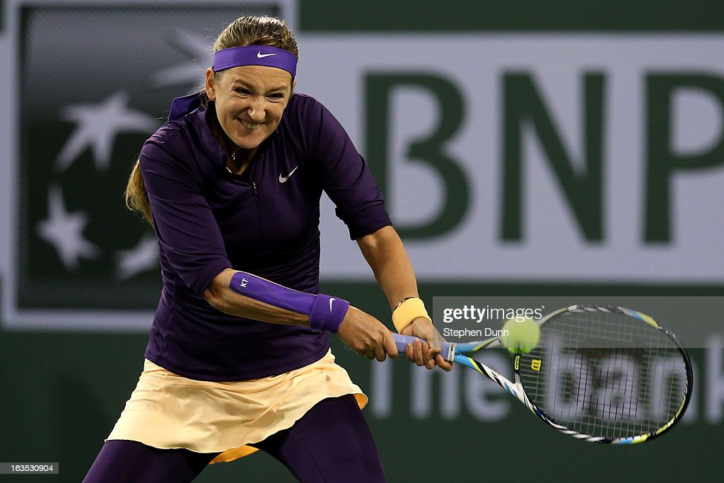 Victoria Azarenka of Belarus hits a return to Kirsten Flipkens of Belgium during day 6 of the BNP Paribas Open at Indian Wells Tennis Garden on March 11, 2013 in Indian Wells, California. (Photo by Stephen Dunn/Getty Images).