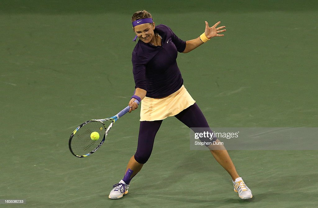 <a gi-track='captionPersonalityLinkClicked' href=/galleries/search?phrase=Victoria+Azarenka&family=editorial&specificpeople=604872 ng-click='$event.stopPropagation()'>Victoria Azarenka</a> of Belarus hits a return to Kirsten Flipkens of Belgium during day 6 of the BNP Paribas Open at Indian Wells Tennis Garden on March 11, 2013 in Indian Wells, California. (Photo by Stephen Dunn/Getty Images).