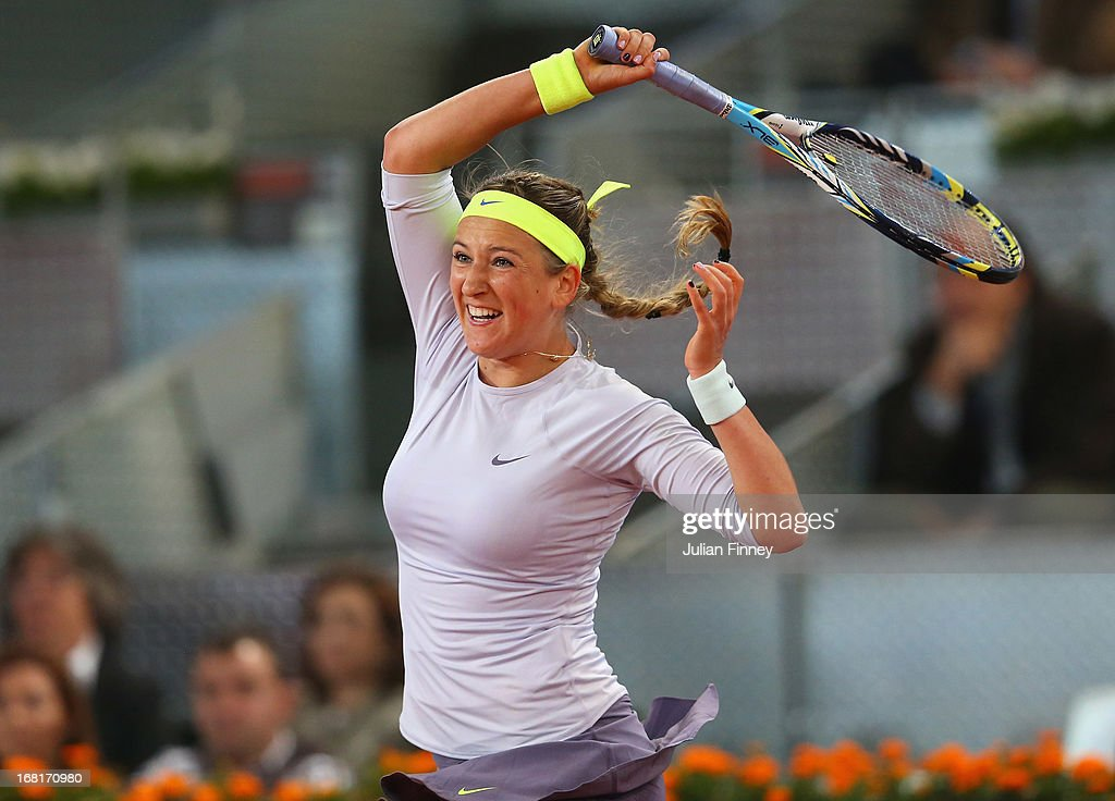<a gi-track='captionPersonalityLinkClicked' href=/galleries/search?phrase=Victoria+Azarenka&family=editorial&specificpeople=604872 ng-click='$event.stopPropagation()'>Victoria Azarenka</a> of Belarus in action against Anastasia Pavlyuchenkova of Russia during day three of the Mutua Madrid Open tennis tournament at the Caja Magica on May 6, 2013 in Madrid, Spain.