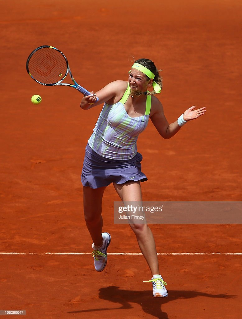 <a gi-track='captionPersonalityLinkClicked' href=/galleries/search?phrase=Victoria+Azarenka&family=editorial&specificpeople=604872 ng-click='$event.stopPropagation()'>Victoria Azarenka</a> of Belarus in action against Ekaterina Makarova of Russia during day five of the Mutua Madrid Open tennis tournament at the Caja Magica on May 8, 2013 in Madrid, Spain.