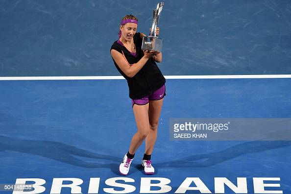 TOPSHOT Victoria Azarenka of Belarus lifts her winning trophy after defeating Angelique Kerber of Germany in the women's final match on the seventh...