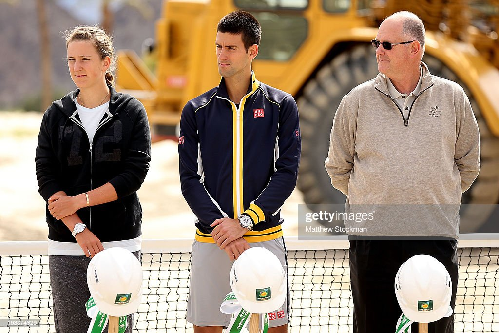Victoria Azarenka of Belarus, Novak Djokovic of Serbia and Steve Simon listen to Larry Ellison, tournament owner and CEO of Oracle, address the media and dignitaries in attendence at the ground breaking ceremony for the Indian Wells Tennis Garden expansion during the BNP Paribas Open at the Indian Wells Tennis Garden on March 8, 2013 in Indian Wells, California.