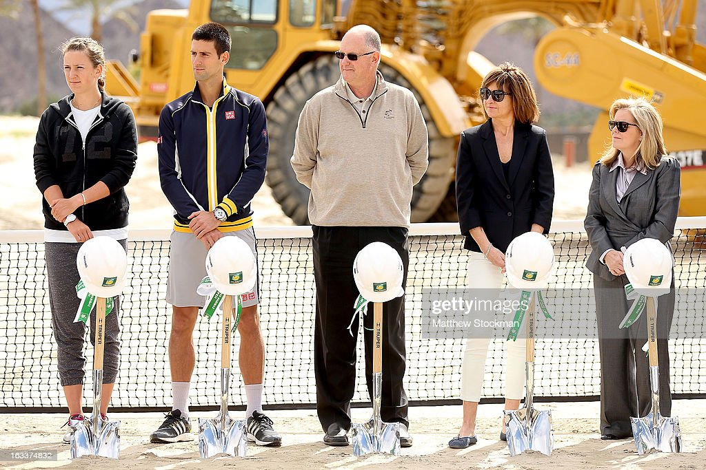 Victoria Azarenka of Belarus, Novak Djokovic of Serbia, Steve Simon, Michelle Sicard and Stacey Allaster, CEO of the WTA, listen to Larry Ellison, tournament owner and CEO of Oracle, address the media and dignitaries in attendence at the ground breaking ceremony for the Indian Wells Tennis Garden expansion during the BNP Paribas Open at the Indian Wells Tennis Garden on March 8, 2013 in Indian Wells, California.