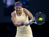 Victoria Azarenka of Belarus plays a backhand in her women's final match against Li Na of China during day thirteen of the 2013 Australian Open at...