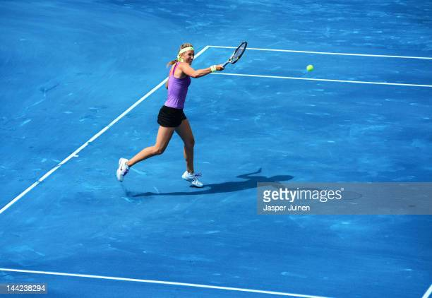 Victoria Azarenka of Belarus plays a backhand to Agnieszka Radwanske of Poland in her semi final match during the Mutua Madrilena Madrid Open tennis...