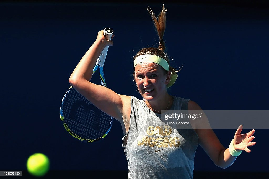 <a gi-track='captionPersonalityLinkClicked' href=/galleries/search?phrase=Victoria+Azarenka&family=editorial&specificpeople=604872 ng-click='$event.stopPropagation()'>Victoria Azarenka</a> of Belarus plays a forehand ahead of the 2013 Australian Open at Melbourne Park on January 7, 2013 in Melbourne, Australia.