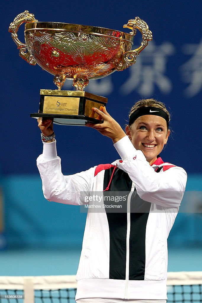 <a gi-track='captionPersonalityLinkClicked' href=/galleries/search?phrase=Victoria+Azarenka&family=editorial&specificpeople=604872 ng-click='$event.stopPropagation()'>Victoria Azarenka</a> of Belarus poses for photographers with the winner's trophy after defeating Maria Sharapova of Russia during the final of the China Open at the China National Tennis Center on October 7, 2012 in Beijing, China.