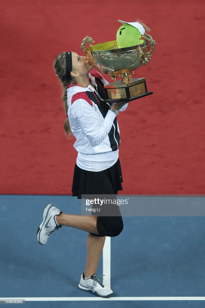 <a gi-track='captionPersonalityLinkClicked' href=/galleries/search?phrase=Victoria+Azarenka&family=editorial&specificpeople=604872 ng-click='$event.stopPropagation()'>Victoria Azarenka</a> of Belarus poses with his trophy during the medal ceremony after the Women's Single Final of the China Open at the China National Tennis Center on October 7, 2012 in Beijing, China.