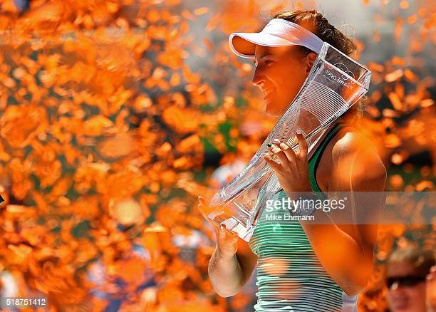 Victoria Azarenka of Belarus poses with the Butch Buchholz Trophy after winning the Women's Final against Svetlana Kuznetsova of Russia during Day 13...