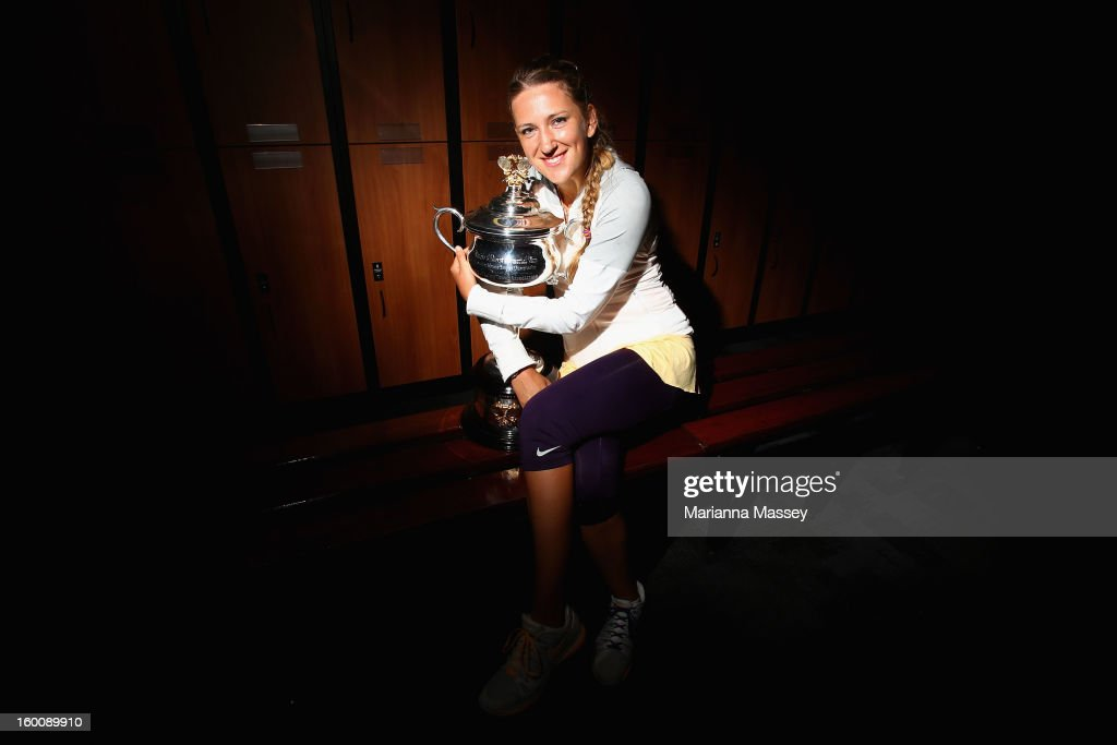 Victoria Azarenka of Belarus poses with the Daphne Akhurst Memorial Cup in the changerooms after winning her women's final match against Na Li of Chinaduring day thirteen of the 2013 Australian Open at Melbourne Park on January 26, 2013 in Melbourne, Australia.