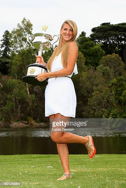 Victoria Azarenka of Belarus poses with the Daphne Akhurst Memorial Cup at The Royal Botanic Gardens after winning the 2013 Australian Open on...