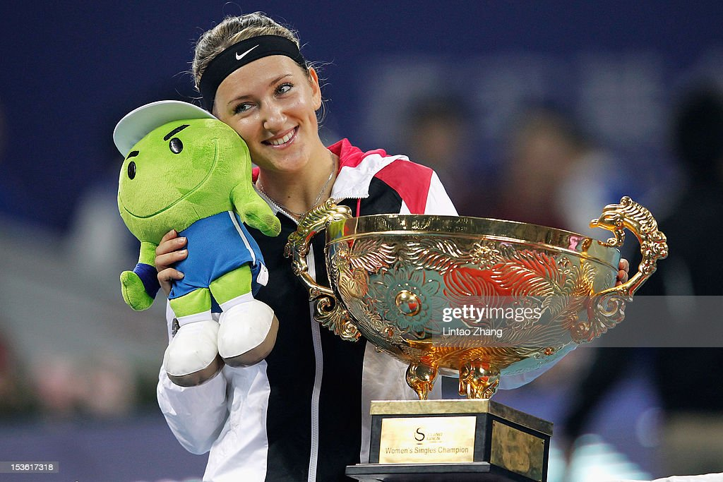 <a gi-track='captionPersonalityLinkClicked' href=/galleries/search?phrase=Victoria+Azarenka&family=editorial&specificpeople=604872 ng-click='$event.stopPropagation()'>Victoria Azarenka</a> of Belarus poses with the trophy after defeating Maria Sharapova of Russia during the Women's Singles Final of the China Open at the China National Tennis Center on October 7, 2012 in Beijing, China.