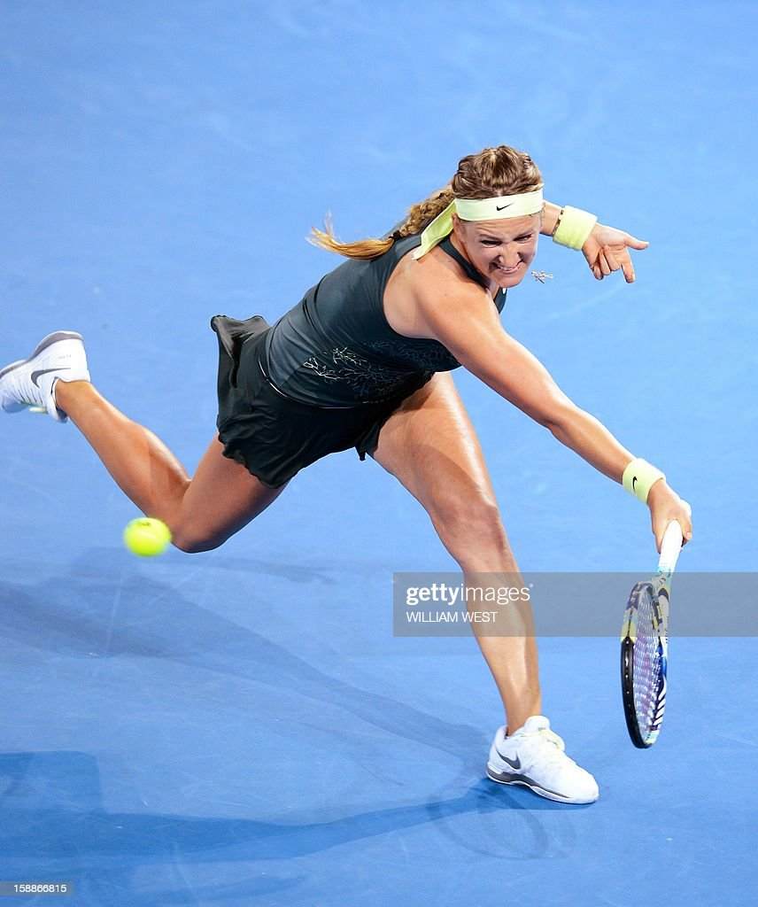 Victoria Azarenka of Belarus reaches for a backhand return against Sabine Lisicki of Germany in the second round at the Brisbane International tennis tournament on January 2, 2013. AFP PHOTO/William WEST USE
