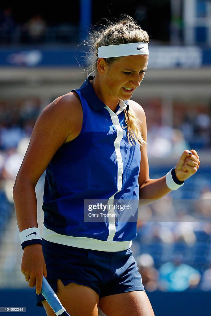 Victoria Azarenka of Belarus reacts against Ekaterina Makarova of Russia during their women's singles quarterfinal match on Day Ten of the 2014 US Open at the USTA Billie Jean King National Tennis Center on September 3, 2014 in the Flushing neighborhood of the Queens borough of New York City.