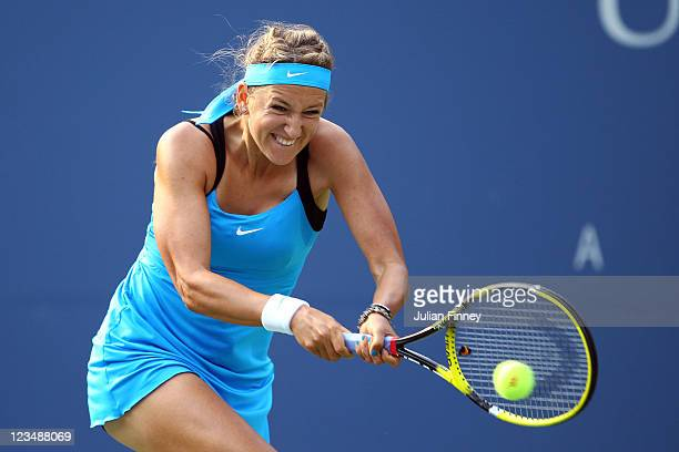 Victoria Azarenka of Belarus returns a shot against Serena Williams of the United States during Day Six of the 2011 US Open at the USTA Billie Jean...