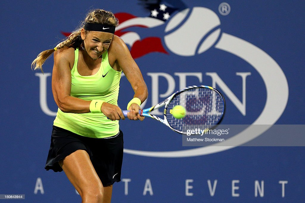 <a gi-track='captionPersonalityLinkClicked' href=/galleries/search?phrase=Victoria+Azarenka&family=editorial&specificpeople=604872 ng-click='$event.stopPropagation()'>Victoria Azarenka</a> of Belarus returns a shot during her women's singles first round match against Alexandra Panova of Russian on Day One of the 2012 US Open at USTA Billie Jean King National Tennis Center on August 27, 2012 in the Flushing neigborhood of the Queens borough of New York City.