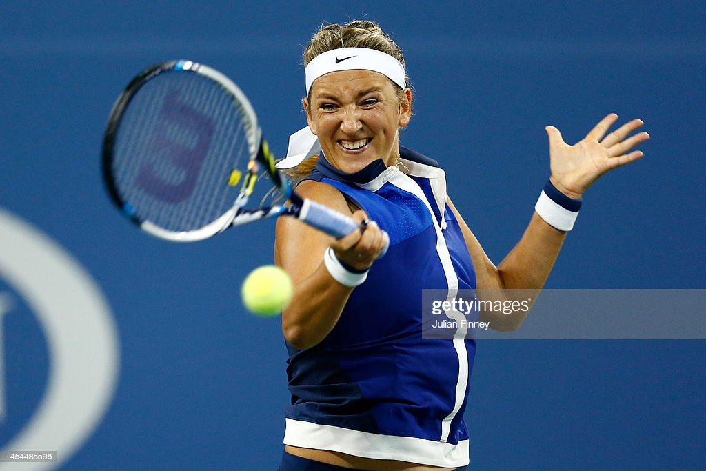 <a gi-track='captionPersonalityLinkClicked' href=/galleries/search?phrase=Victoria+Azarenka&family=editorial&specificpeople=604872 ng-click='$event.stopPropagation()'>Victoria Azarenka</a> of Belarus returns a shot to Aleksandra Krunic of Serbia during their women's singles fourth round match on Day Eight of the 2014 US Open at the USTA Billie Jean King National Tennis Center on September 1, 2014 in the Flushing neighborhood of the Queens borough of New York City.