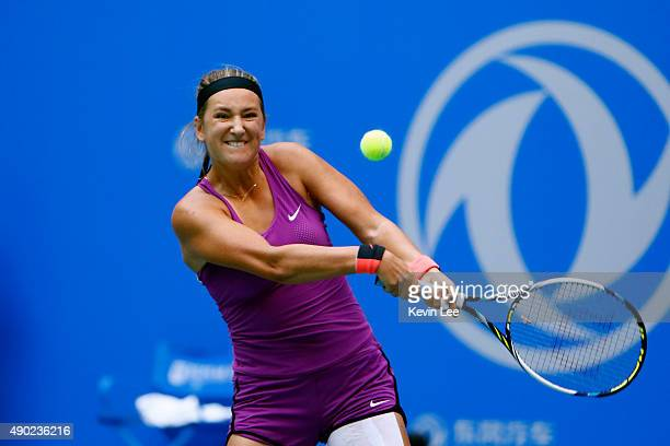 Victoria Azarenka of Belarus returns a shot to Lauren Davis of United States on day 1 of 2015 Dongfeng Motor Wuhan Open at Optics Valley...