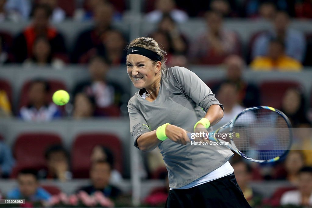 <a gi-track='captionPersonalityLinkClicked' href=/galleries/search?phrase=Victoria+Azarenka&family=editorial&specificpeople=604872 ng-click='$event.stopPropagation()'>Victoria Azarenka</a> of Belarus returns a shot to Maria Sharapova of Russia during the final of the China Open at the China National Tennis Center on October 7, 2012 in Beijing, China.