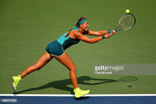 Victoria Azarenka of Belarus returns a shot to Yanina Wickmayer of Belgium during their Women's Singles Second Round match on Day Four of the 2015 US...