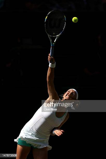 Victoria Azarenka of Belarus serves during her Ladies' Singles semi final match against Serena Williams of the USA on day ten of the Wimbledon Lawn...