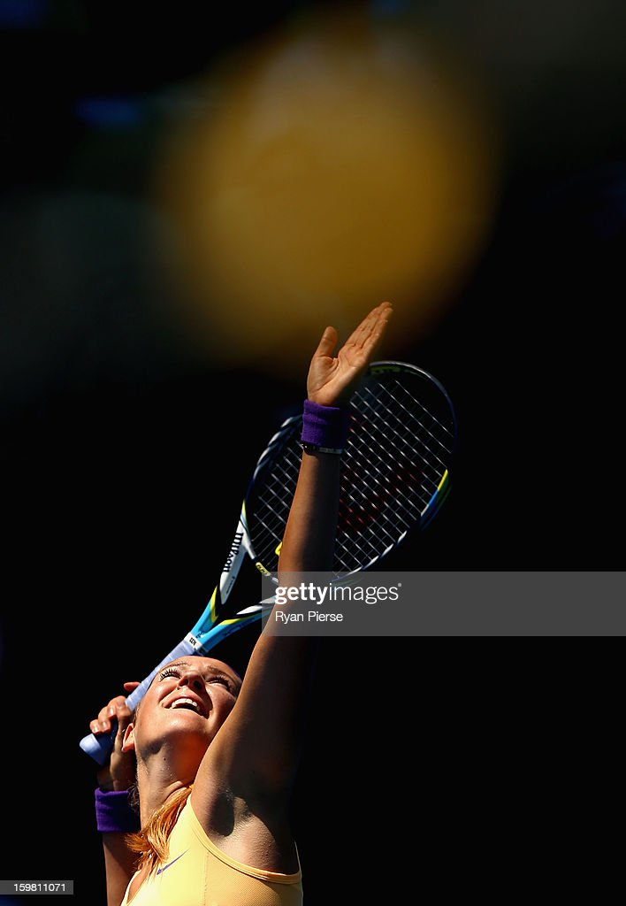 <a gi-track='captionPersonalityLinkClicked' href=/galleries/search?phrase=Victoria+Azarenka&family=editorial&specificpeople=604872 ng-click='$event.stopPropagation()'>Victoria Azarenka</a> of Belarus serves in her fourth round match against Elena Vesnina of Russia during day eight of the 2013 Australian Open at Melbourne Park on January 21, 2013 in Melbourne, Australia.
