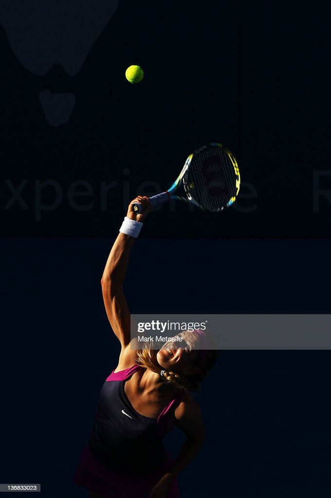 <a gi-track='captionPersonalityLinkClicked' href=/galleries/search?phrase=Victoria+Azarenka&family=editorial&specificpeople=604872 ng-click='$event.stopPropagation()'>Victoria Azarenka</a> of Belarus serves in her match against Agnieszka Radwanska of Poland during day five of the 2012 Sydney International at Sydney Olympic Park Tennis Centre on January 12, 2012 in Sydney, Australia.