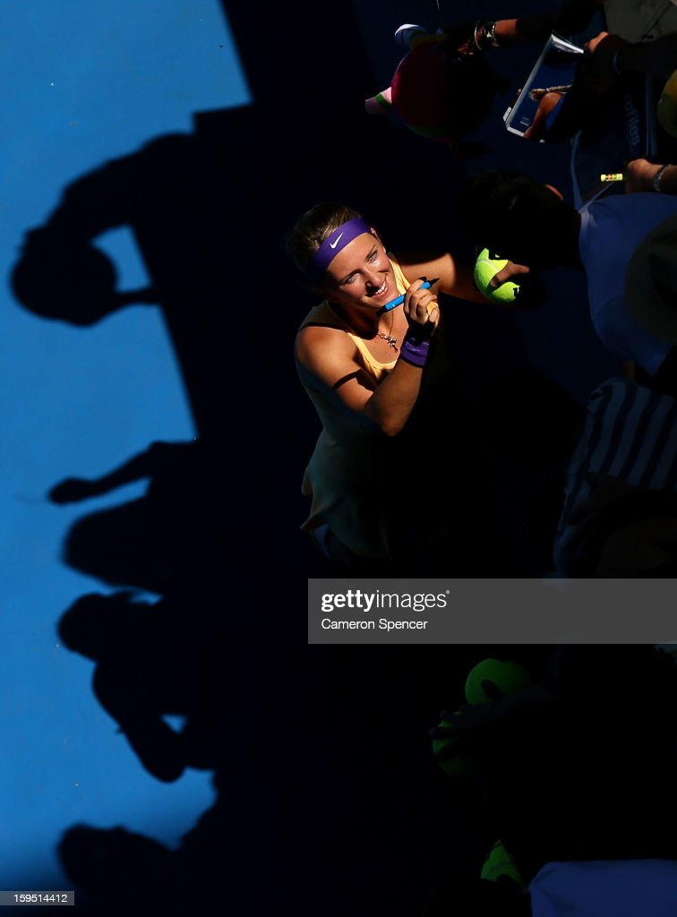 <a gi-track='captionPersonalityLinkClicked' href=/galleries/search?phrase=Victoria+Azarenka&family=editorial&specificpeople=604872 ng-click='$event.stopPropagation()'>Victoria Azarenka</a> of Belarus signs autographs for fans after winning her first round match against Monica Niculescu of Romania during day two of the 2013 Australian Open at Melbourne Park on January 15, 2013 in Melbourne, Australia.