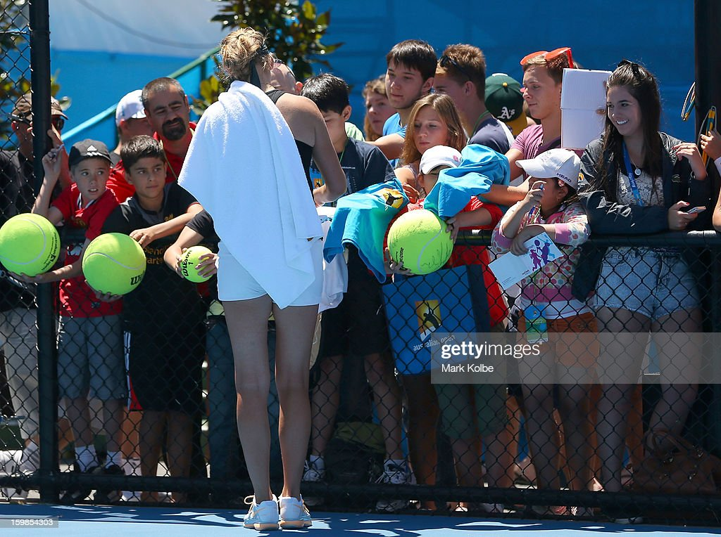 Victoria Azarenka of Belarus signs autographs for fans following a practice session during day nine of the 2013 Australian Open at Melbourne Park on January 22, 2013 in Melbourne, Australia.