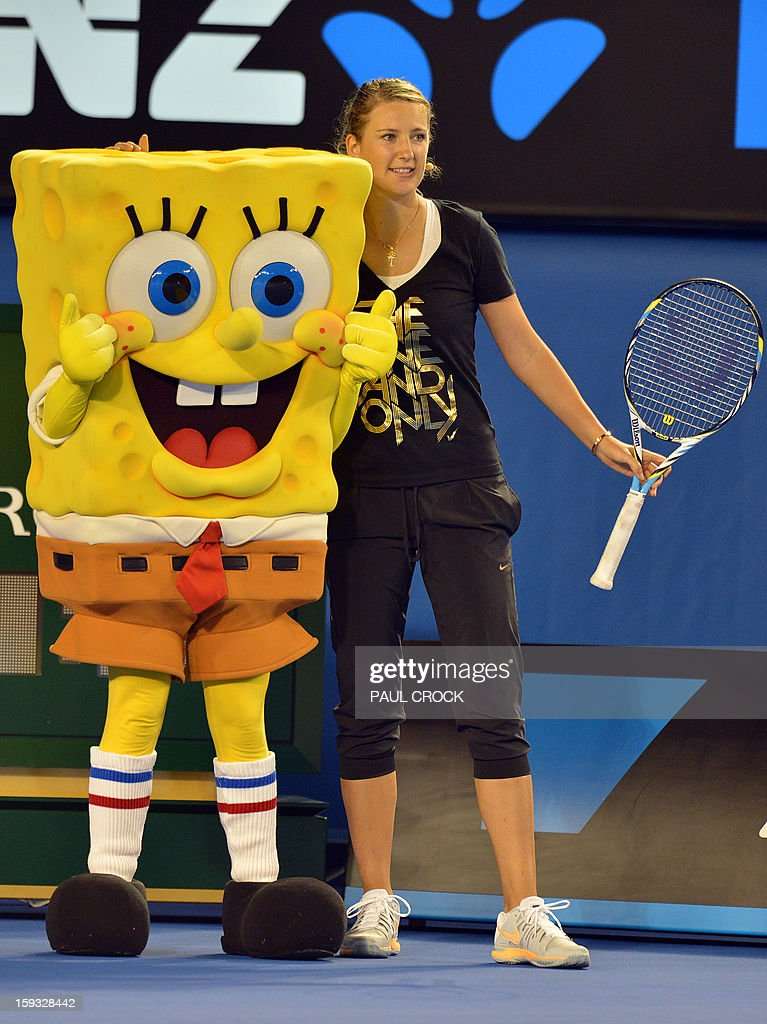 Victoria Azarenka of Belarus (R) stands next to cartoon character Sponge Bob during a Kids Day exhibition match in the lead-up to the Australian Open tennis tournament in Melbourne on January 12, 2013. The first Grand Slam tennis tournament of the year is set to run from January 14 to 27. AFP PHOTO / Paul CROCK USE