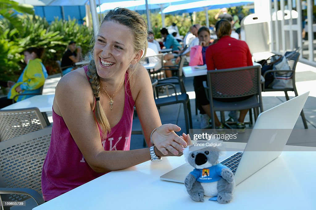 Victoria Azarenka of Belarus watches herself play piano on her laptop during day nine of the 2013 Australian Open at Melbourne Park on January 22, 2013 in Melbourne, Australia.