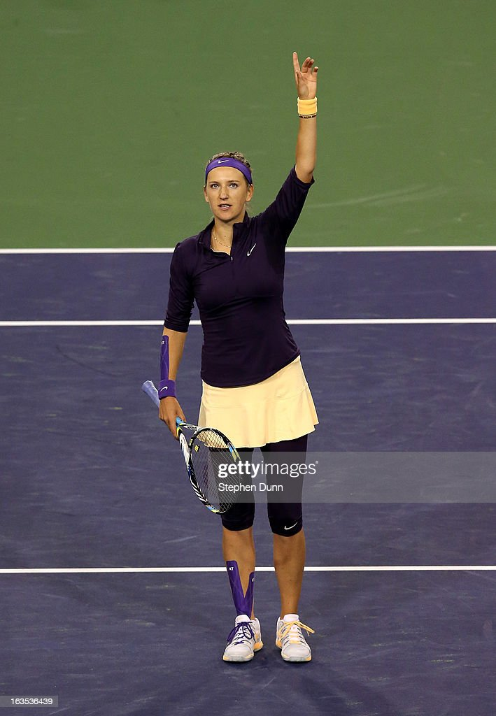 Victoria Azarenka of Belarus waves to the crowd after defeating Kirsten Flipkens of Belgium during day 6 of the BNP Paribas Open at Indian Wells Tennis Garden on March 11, 2013 in Indian Wells, California. (Photo by Stephen Dunn/Getty Images).