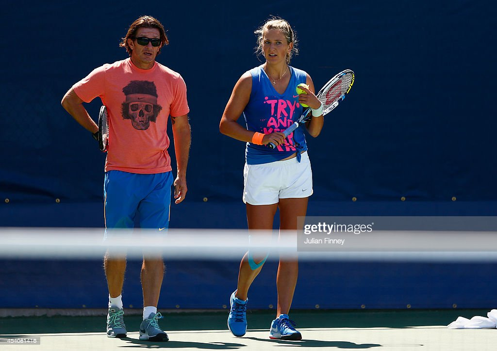 <a gi-track='captionPersonalityLinkClicked' href=/galleries/search?phrase=Victoria+Azarenka&family=editorial&specificpeople=604872 ng-click='$event.stopPropagation()'>Victoria Azarenka</a> of Belarus with coach Sam Sumyk in a practice session during previews for the US Open tennis at USTA Billie Jean King National Tennis Center on August 24, 2014 in New York City.