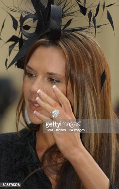 Victoria Beckham after her husband David Beckham received the OBE he received from Britain's Queen Elizabeth II at London's Buckingham Palace