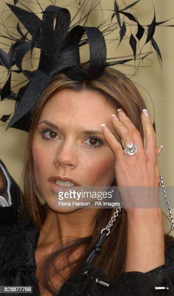Victoria Beckham after her husband David Beckham the England football team Captain recieved an Order of the British Empire from the Queen at...