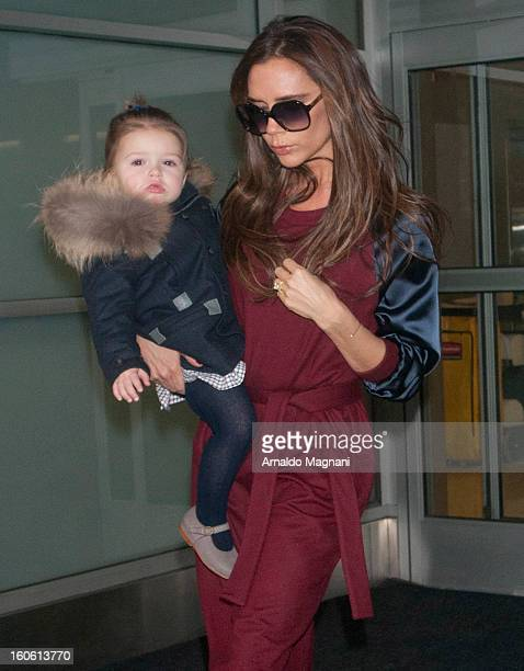 Victoria Beckham and daughter Harper Beckham land at John F Kennedy Airport on February 3 2013 in New York City