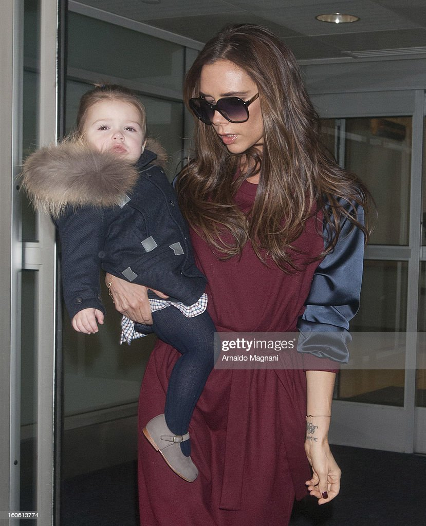 <a gi-track='captionPersonalityLinkClicked' href=/galleries/search?phrase=Victoria+Beckham&family=editorial&specificpeople=161100 ng-click='$event.stopPropagation()'>Victoria Beckham</a> and daughter, <a gi-track='captionPersonalityLinkClicked' href=/galleries/search?phrase=Harper+Beckham&family=editorial&specificpeople=8262359 ng-click='$event.stopPropagation()'>Harper Beckham</a> land at John F. Kennedy Airport on February 3, 2013 in New York City.