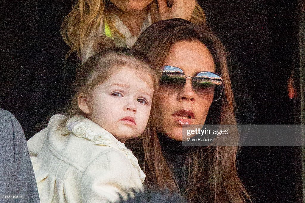 Victoria Beckham and Harper Seven Beckham are seen during the french Ligue 1 match between Nancy FC and Paris SaintGermain FC at Parc des Princes on...