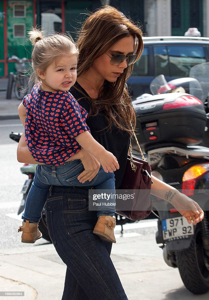 <a gi-track='captionPersonalityLinkClicked' href=/galleries/search?phrase=Victoria+Beckham&family=editorial&specificpeople=161100 ng-click='$event.stopPropagation()'>Victoria Beckham</a> and her daughter Harper Seven are seen arriving at the 'BONTON' store on May 4, 2013 in Paris, France.