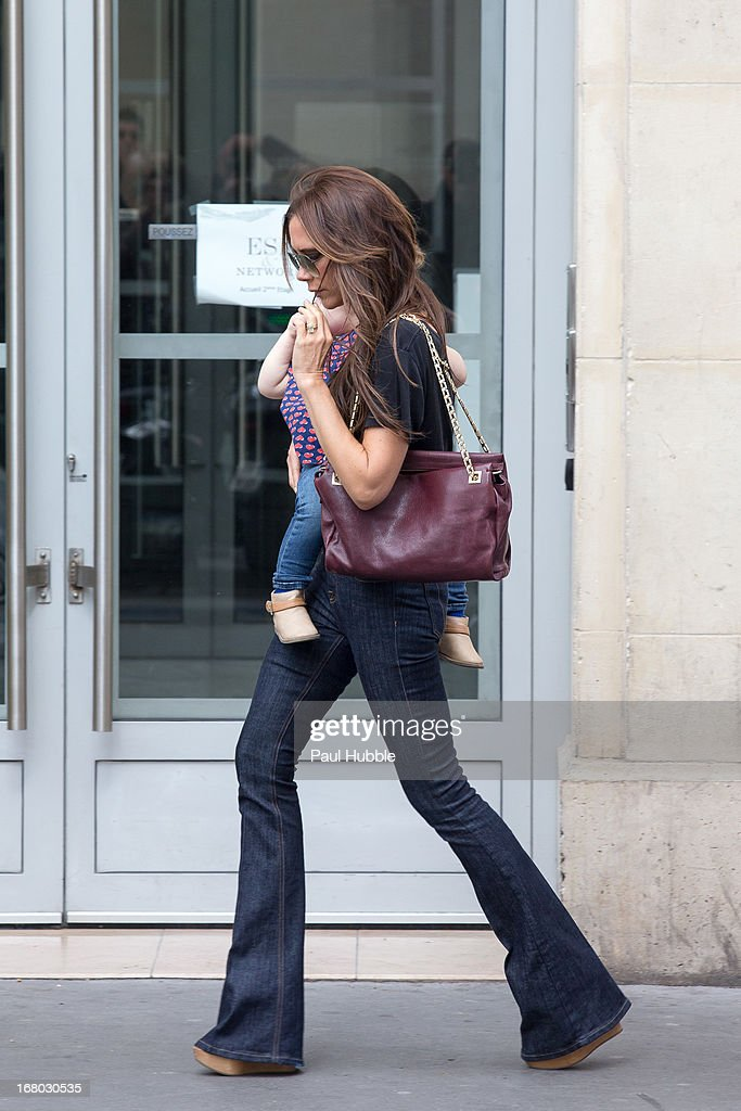 Victoria Beckham and her daughter Harper Seven are seen leaving the 'Marks & Spencer' store on May 4, 2013 in Paris, France.