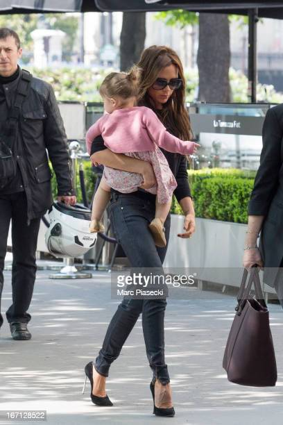 Victoria Beckham and her daughter Harper Seven Beckham are seen arriving at the 'Matignon' restaurant on April 21 2013 in Paris France