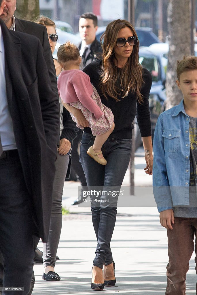 Victoria Beckham and her daughter Harper Seven Beckham are seen arriving at the 'Matignon' restaurant on April 21, 2013 in Paris, France.