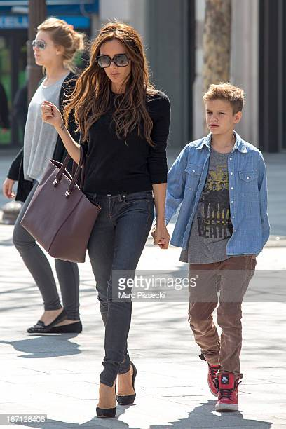 Victoria Beckham and her son Romeo James are seen leaving the 'NIKE' store on the ChampsElysees Avenue on April 21 2013 in Paris France
