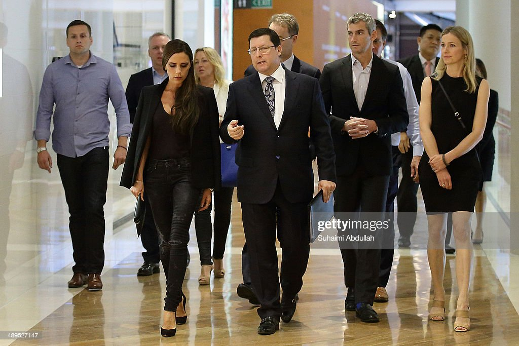 Victoria Beckham and John Postle, Vice President of Retail for the Marina Bay Sands are seen in The Shoppes at the Marina Bay Sands on May 11, 2014 in Singapore. Victoria Beckham is in Singapore for the first time to showcase her ready-to-wear pieces from her eponymous fashion label in Singapore