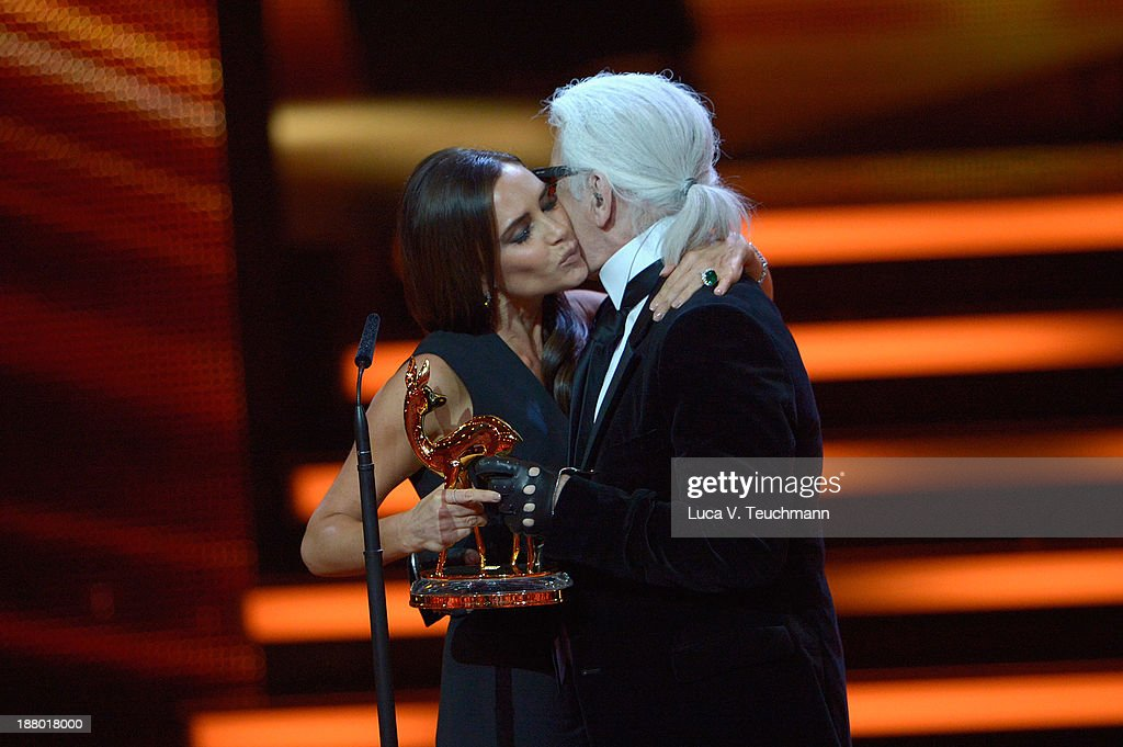 Victoria Beckham and Karl Lagerfeld talk on stage at the Bambi Awards 2013 at Stage Theater on November 14, 2013 in Berlin, Germany.