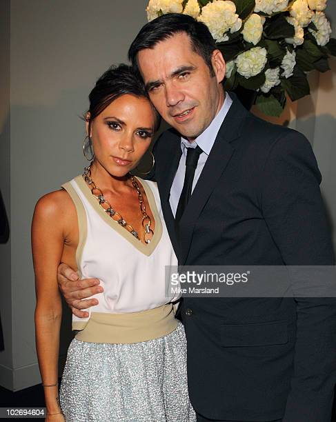 Victoria Beckham and Roland Mouret attend the 10th Birthday party for NetAPorter at Westfield on July 7 2010 in London England